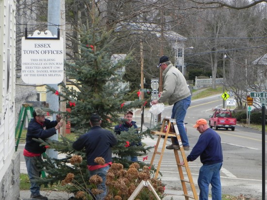 The Essex Highway Department decorates the Town Christmas tree