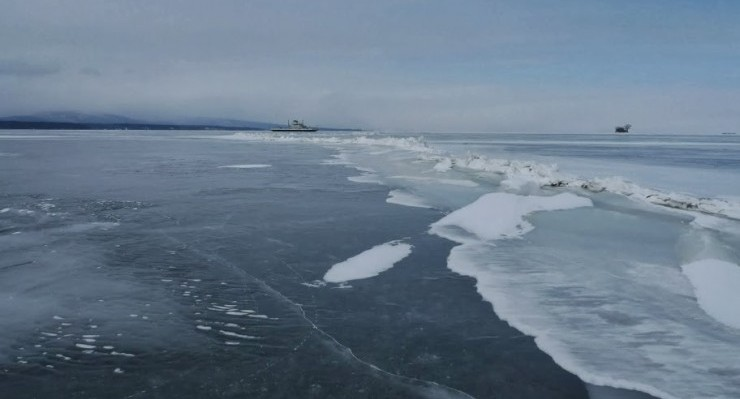 Crack in the ice on Lake Champlain; ferry in the distance (Credit: Catherine Seidenberg)