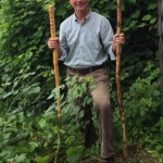 Chris Maron displaying two of the walking sticks created by Don Rennell. (Credit: CATS)